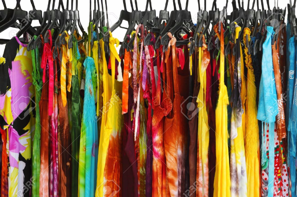 12657903-A-row-of-summer-clothes-hanging-on-the-rack-Stock-Photo-clothes-clothing-closet